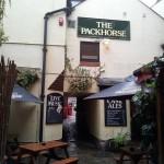 The pub fills the alleyway with its decent beer garden.