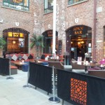 The bar's entrance and beer garden in The Electric Press courtyard.