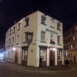 The Old Red Lion stands alone just south of the river.