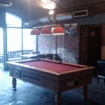 This red pool table has pride of place in one of the four rooms.