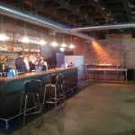 This is the bar area. Beer pong is at the back.